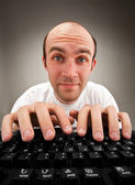 Funny nerd working on computer — Stock Photo