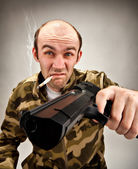 Impudent bandit with gun — Stock Photo