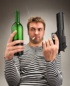 Bizarre sailor choosing between bottle and gun — Stock Photo