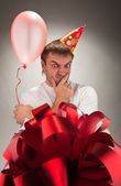 Birthday man looking big gift box — Stock Photo