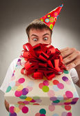 Birthday man opening gift box — Stock Photo