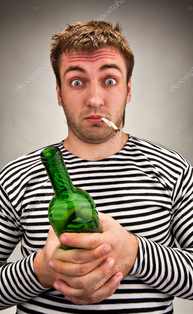 Drunk bizarre sailor with bottle and cigarette — Stock Photo #5226941