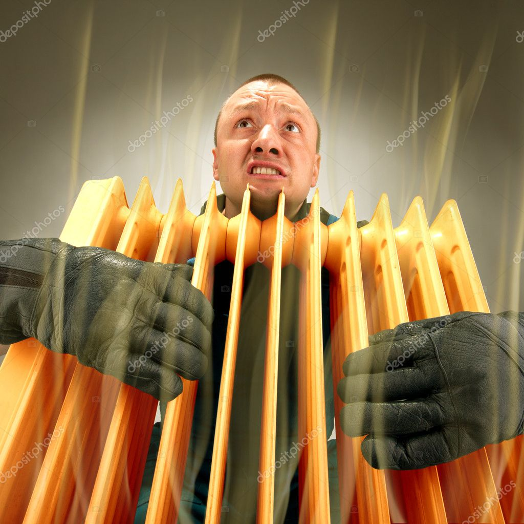 Bizarre freezing man holding hot oil radiator — Stock Photo #5226990