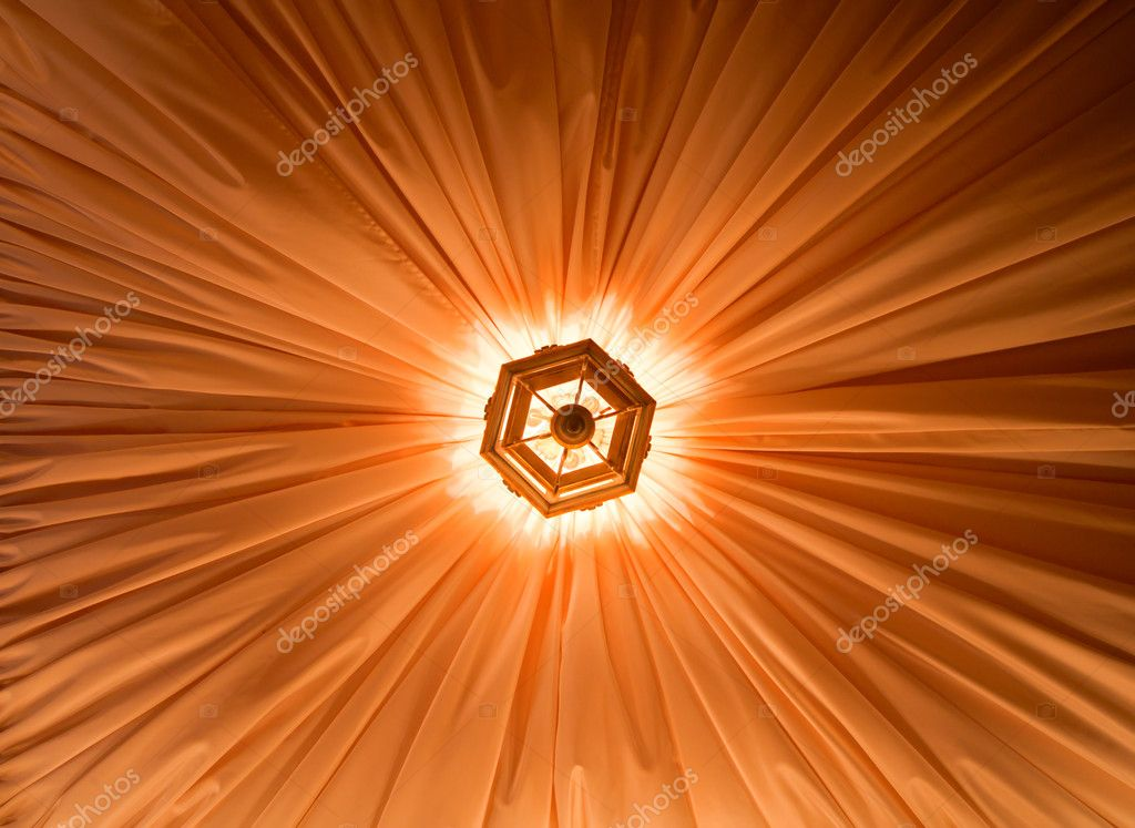 Background of yellow silk ceiling with chandelier in center — Stock Photo #5227000