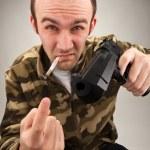 Impudent bandit with gun — Stock Photo #5236206