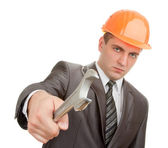Serious engineer in hardhat with spanner — Stock Photo