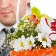 Bouquet of flowers against happy groom — Stock Photo #5346895