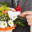 Happy businessman with basket of flowers — Stock Photo #5347743