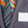 Businessman in grey suit and colorful shirt — Stock Photo