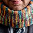 Businessman in grey suit and colorful scarf — Stock Photo