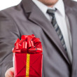 Red gift in hand — Stock Photo #5348414