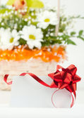 Gift card against basket of flowers — Stock Photo