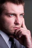 Businessman looking for solutions — Stock Photo