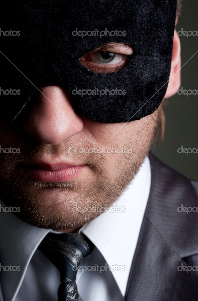 Portrait of serious businessman in mask looking to you — Stock Photo #5348484