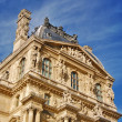 Louvre Museum in Paris, France - Stock Photo