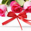 Invitation card and roses — Stock Photo