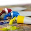 Palette and tubes of oil paint — Stock Photo