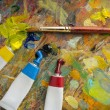 Palette with paint brush and tubes of oil paint — Stock Photo #4287990