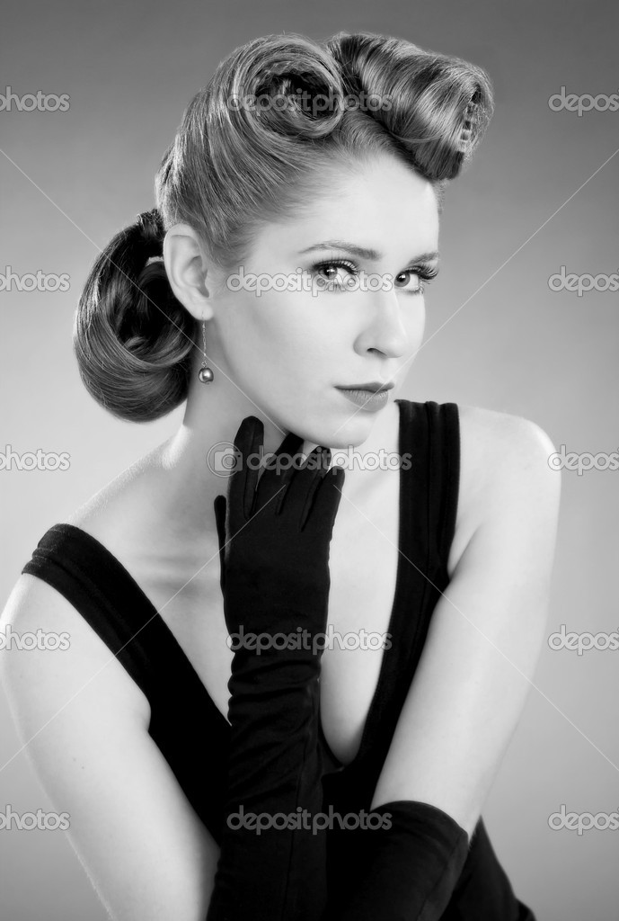 Beautiful blond model with fifties glamour look, black gloves and dress — Stock Photo #4081990