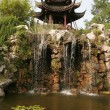 China. Waterfalls and ancient pagodas - Foto Stock