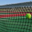 Stock Photo: Yellow Tennis Ball Hitting Net