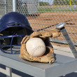 Stock Photo: White Softball, Helmet, Bat, and Glove