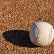 White Softball on the Infield — Stock Photo