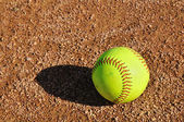 Yellow Softball on the Infield — Stock Photo