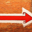 Red Arrow Painted on a Brick Wall — Stock Photo