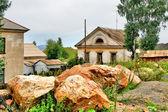 Boulders near a house — Stock Photo