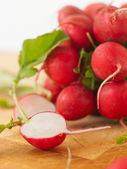 Fresh radishes on white background — Stock Photo