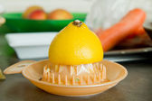 Lemon with squeezer — Stock Photo