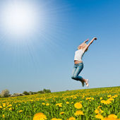 Happy young woman on meadow — Stock Photo