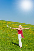 Young woman with a red scarf on a meadow — Stock Photo