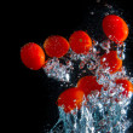 Tomatoe splash — Stock Photo