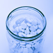 Pills in glass container - Foto de Stock  