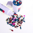 Pills spilling out of container - Stock Photo