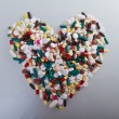 Various pills in a shape of heart - Stock Photo