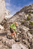 Female climbing ferrata in julian alps, slovenia — Stock Photo