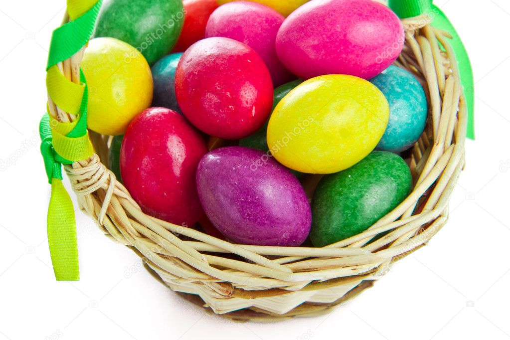 Closeup of colorful easter eggs in basket isolated  Stock Photo #5293744