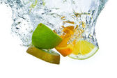 Fruit splashing — Stock Photo