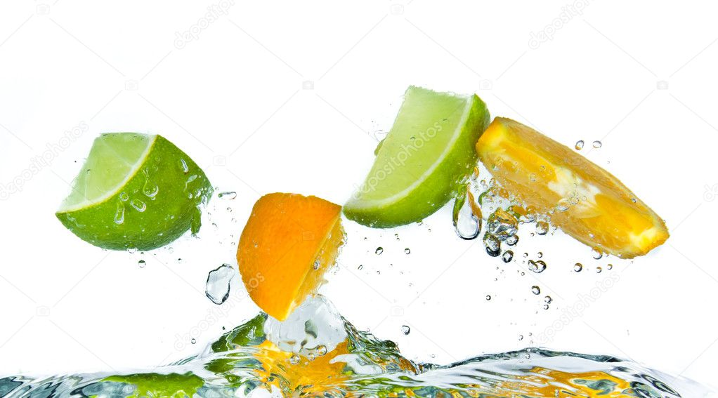 Citrus fruit splashing isolated on white background — Stock Photo #5349689