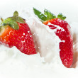 Royalty-Free Stock Photo: Strawberry splashing into milk