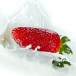 Strawberry splashing into milk — Stock Photo #5366114