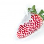 Strawberry splashing into milk — Stock Photo