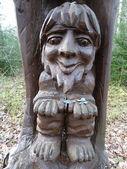 Wooden sculpture on the tree — Stock Photo