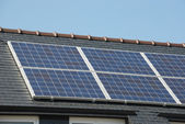 House with solar panels on roof — Stock Photo