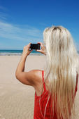 Woman taking picture — Stock Photo