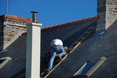 Roofer working next to the chimney — Stock Photo