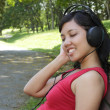 Woman listening to music — Stock fotografie #4105983